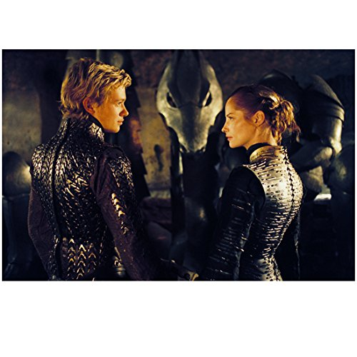 (Eragon Ed Speelers and Sienna Guillory as Arya in Matching Black Outfits Gazing into Each Other's Eyes 8 x 10 Inch)