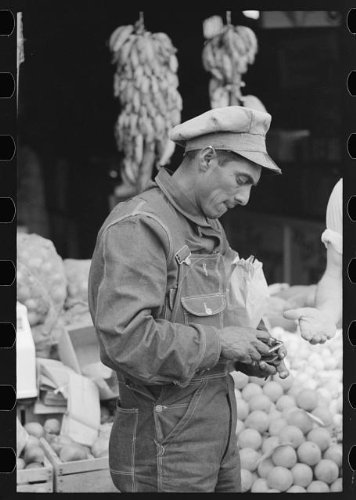 Photo: Mexican worker paying for merchandise,market - Shopping Texas Waco In