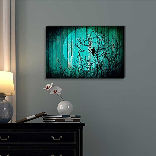 Silhouette of a Tree with a Crow on The Branches and The Moon on The Back Over Teal Wood Panels