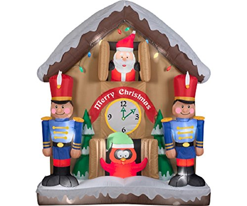 CHRISTMAS INFLATABLE ANIMATED SANTA CUCKOO CLOCK WITH TOY SOLDIERS BY GEMMY