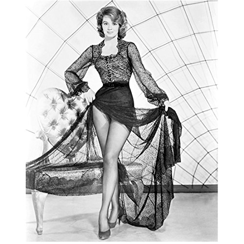 Angie Dickinson (8 inch by 10 inch) PHOTOGRAPH Police Woman Rio Bravo Dressed to Kill B&W Pic Showing Off Legs Holding Up Lace Skirt Next to Bench (Rio Bench)