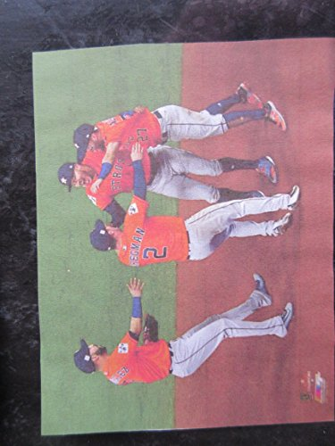 HOUSTON ASTROS INFIELDERS CELEBRATE THEIR 2017 WORLD SERIES CHAMPIONSHIP PHOTO MOUNTED ON A CLEAR HOLDER ON A