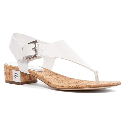 9377eaf0291 MICHAEL Michael Kors Women s London Thong Sandal Optic White 6.5 M   Amazon.ca  Shoes   Handbags