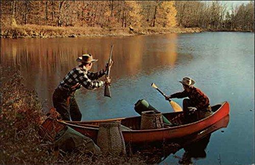 Fishermen in Canoe sighing a Deer Hunting Original Vintage Postcard