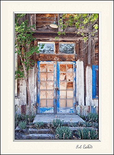 16 x 20 mat including an art decor photograph of a well worn wooden blue door with reflecting window panes at distressed abandoned garden home in a New Mexico ghost town. - Architectural Pan