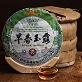 Rong's 2009 [Early Spring Yulu] Pu'er raw tea,Qizibing Tea [Rong's 10-year Thanksgiving Return] High fragrance,The palate is rich and full,Air foot rhyme length,98.7 ounces,Send mahogany tea needles
