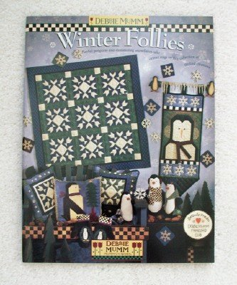 (Winter follies: [playful penguins and shimmering snowflakes take center stage in this collection of quilted creations.] )