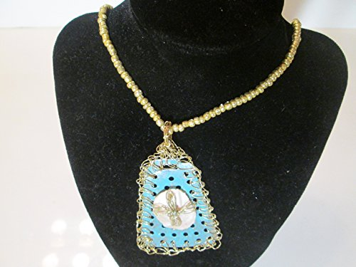 - Beaded necklace & crochet wire cross on oyster shell, painted metal pendant.
