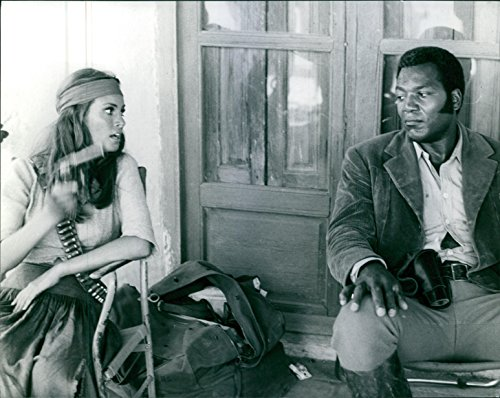 Vintage photo of Still from the film 100 Rifles with Raquel Welch and Jim Brown.