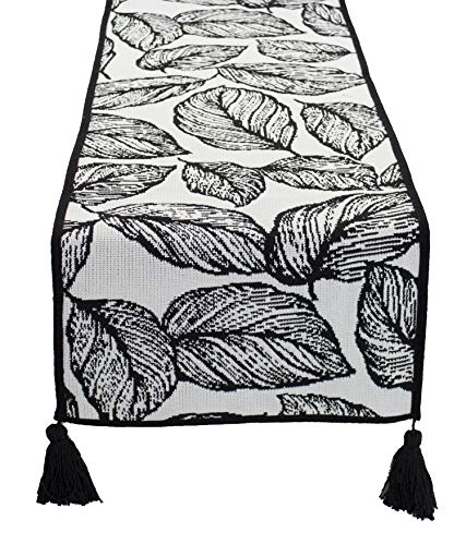 Fennco Styles Black and White Leaf Woven Table Runner - 14 x 71 Inch Reversible Runner Table Centerpiece for Dining Home Decor, Indoor Parties, Holiday Events Tassel Table Runner]()