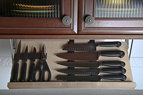 A wooden, under-the-cabinet knife storage with a natural tone.
