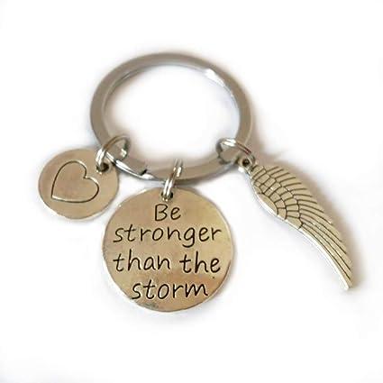Llavero con mensaje «Be Stronger than the Storm», con alas ...