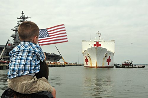 Family and friends watch as hospital ship USNS Comfort (T-AH 20) docks at Naval Station Norfolk, Va.