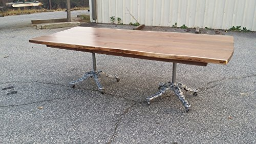Live Edge Walnut Dining Table with antique cast iron bases