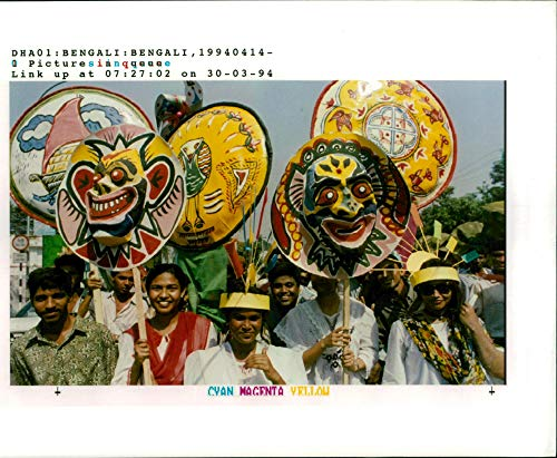 Vintage photo of View of Bangladesh:young and old march with colourful masks.