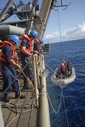 sailors-aboard-the-harpers-ferry-class-dock-landing-ship-uss-oak-hill-lsd-51-hoist-up-a-rigid-hu