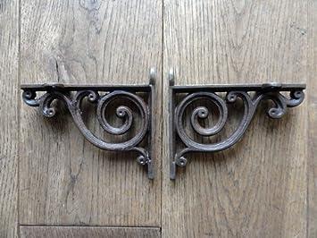 pair of small victorian style cast iron shelf brackets