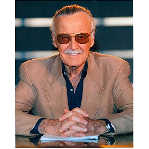 Stan Lee 8 Inch x10 Inch Photo Writer Producer Actor Iron Man Spider-Man Seated Wearing Tan Jacket Over Navy Blue Shirt Pose 1 kn