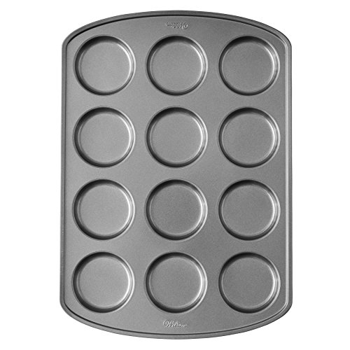 - Wilton Perfect Results Premium Non-Stick Bakeware Muffin Top Baking Pan, Enjoy the Best Part of the Muffin, Also Great for Eggs, Corn Bread and More, 12 Cavities