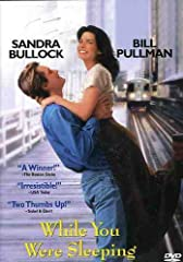 You'll fall in love with WHILE YOU WERE SLEEPING, the hit romantic comedy that woke everyone up to adorable Sandra Bullock (SPEED, A TIME TO KILL). As Lucy, a lonely subway worker, she becomes smitten with a handsome stranger (Peter Gallagher...