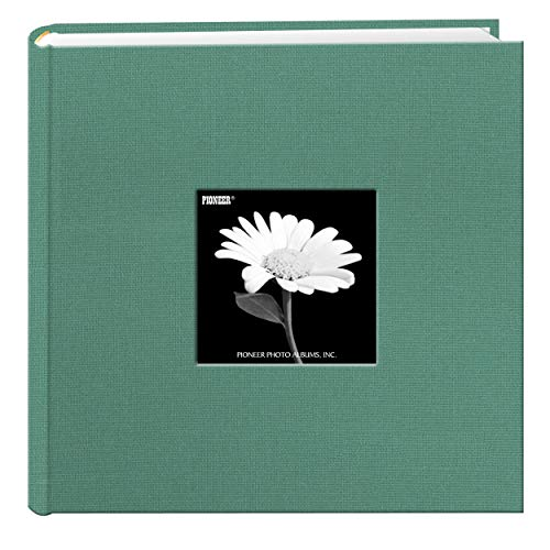 This fabric cover photo album features a frame to insert a favorite photo and a deluxe rounded bookbound spine. The album's patented Bi-Directional pockets hold horizontal or vertical photos up to 4 x 6 inches. There is a memo writing area next to ea...