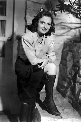 Donna Reed leaning on knee in boots outside door smiling 24x36 Poster Boot Reed