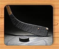 Hockeyschläger und Puck Maus Pad