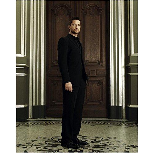 Gerard Butler Wearing Black Suit Hand in Pocket Standing on Ornate Tile Floor Large Wood Doors in Background 8 X 10 Inch Photo