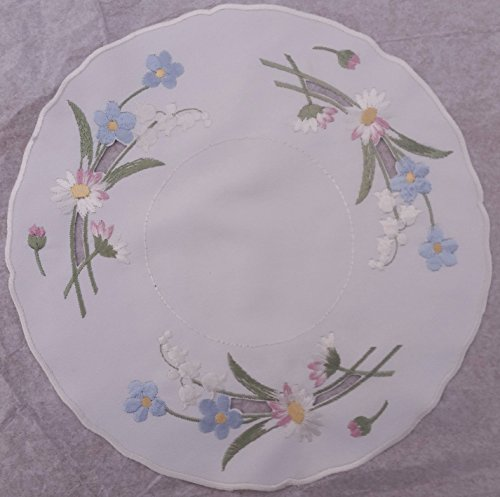 (Linen doily with daisy, forget me knots and lily of the valley 11 inches round)