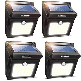 Neloodony - Luces solares inalámbricas para exteriores con sensor de movimiento de 28 LED, luz