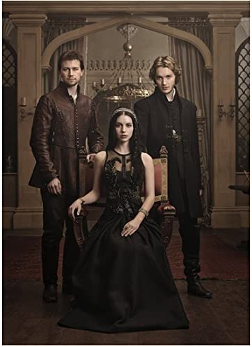 Reign Adelaide Kane in throne with Torrance Coombs and Toby Regbo in castle  8 x 10 Inch Photo at Amazon's Entertainment Collectibles Store