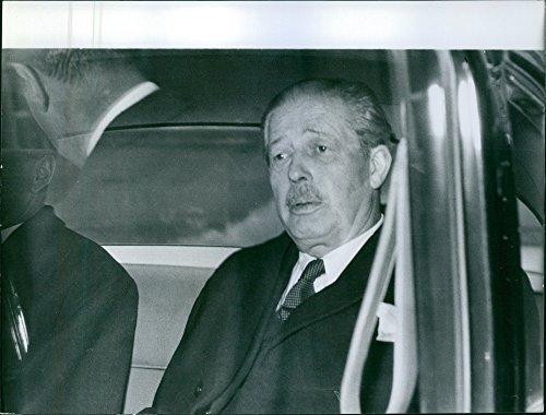 Vintage photo of Harold Macmillan inside the vehicle. ()