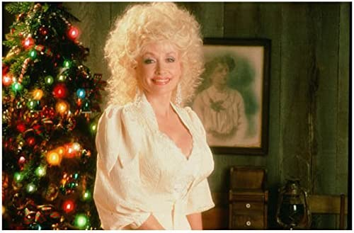 Dolly Parton Christmas.Dolly Parton In White Lacy Dress With Cleavage Christmas