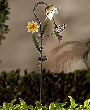 Jardín mariposa, colibrí y libélula Solar flor juego por lago ...