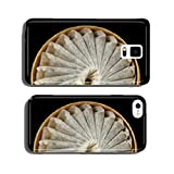 A bunch of swedish snus in a round container isolated on black cell phone cover case iPhone6