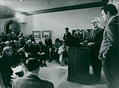 Door Secretary - Vintage photo of Henry Kissinger during a press conference in the White House, White House Secretary Ron Ziegler next door,
