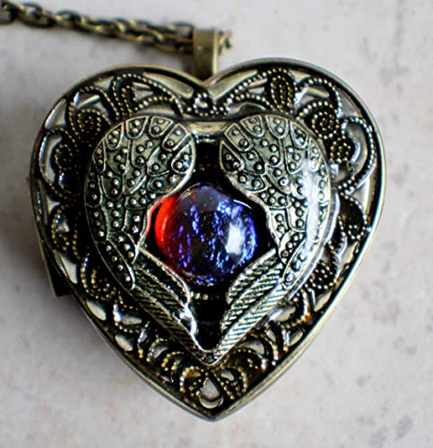 - Angel Wings and Dragons Breath Glass Fire Opal Music Box Locket