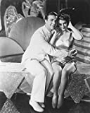 Dick Powell in Gold Diggers of 1933 seated while embracing show girl 16x20 Canvas