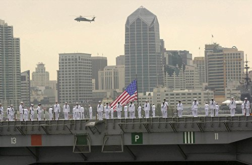 Home Comforts Laminated Poster Backed by The San Diego Skyline, Crew Members Man The Rails Aboard USS Ronald Reagan (CVN 76) During Vivid Imagery Poster Print 24 x 36 (San Diego Crew)