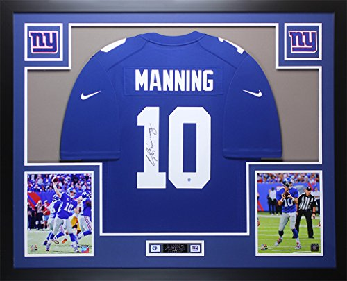 Eli Manning Autographed Blue New York Giants Jersey - Beautifully Matted and Framed - Hand Signed By Eli Manning and Certified Authentic by Auto PSA COA - Includes Certificate of ()