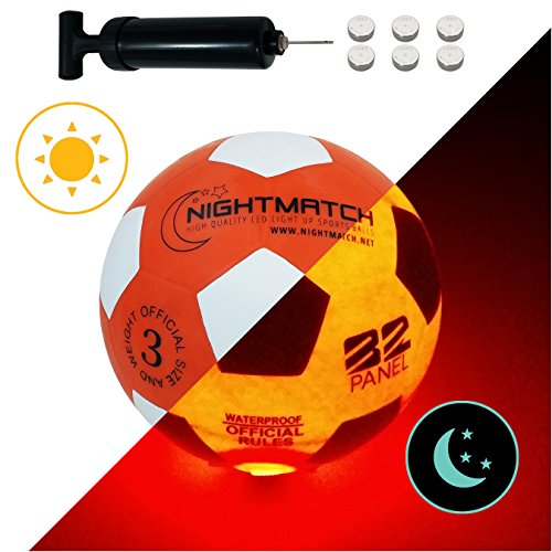NightMatch Light Up Soccer Ball Kids Edition INCL BALL PUMP and SPARE BATTERIES - Inside LED lights up when kicked - Glow in the Dark Soccer Ball - Youth Size 3 - Official Size & Weight - orange/white -
