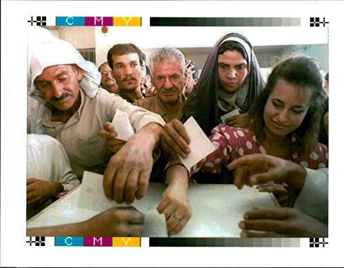 (Vintage photo of Iraqis Cast their ballots at a polling station.)
