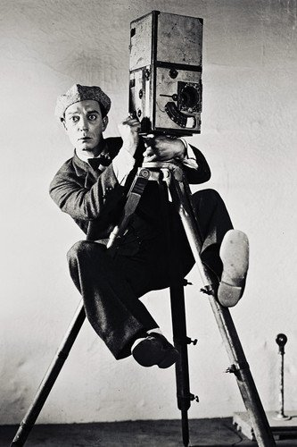 Buster Keaton climbing on Movie Camera Poster
