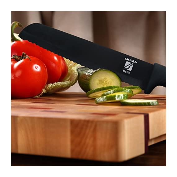 "6"" Ceramic Blade Chef's Knife by Sharp Box - Professional Quality with U-Shaped Ergonomic Handle - Eco-Friendly Product - BLACK Blade 5 EFFORTLESS CUTTING - Our black, 6 inch, professional grade, CERAMIC utility knife is ultra-sharp. This Japanese inspired chef knife delivers smooth, high-precision chopping, mincing, slicing, and dicing power. The serrated blade is no match for bread, bagels, tomatoes, fruits, and vegetables. A must have for any amateur or seasoned chef and a needed addition to any kitchen flatware set. NO SHARPENING - Our high tech ceramic blade is ground to microscopic precision by diamond wheels for a rock-like edge that is 10x sharper than stainless steel and will not dull for years. This RAZOR like edge retention means no sharpening for years to come. WORRY FREE AND EASY TO CLEAN - Less exposure to germs and bacteria because ceramic is NON-POROUS and chemically stable. And, unlike metal blades, our pure ceramic blades are rust and corrosion free. Our super sharp, ceramic knives don't react chemically with acids, oils, salts, or juices that can change the flavor of your food like steel knives do. Not only will this knife not leave your food with a metallic taste as others might, it also wipes away and cleans in seconds!"