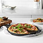 AmazonBasics Pre-Seasoned Cast Iron Pizza Pan, 13.5 Inch 11 13.5-inch pre-seasoned cast-iron pizza pan for baking pizza to delicious perfection Heavy-duty cast-iron construction provides optimal heat retention and thorough, even heating 2 loop side handles for a steady, secure hold when lifting or carrying