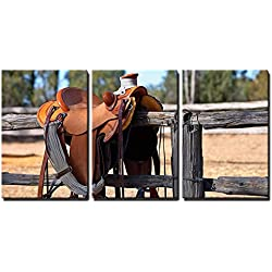 "wall26 - 3 Piece Canvas Wall Art - a Western Style Saddle Siting upon a Country Fence Beside a Riding Arena. - Modern Home Decor Stretched and Framed Ready to Hang - 16""x24""x3 Panels"