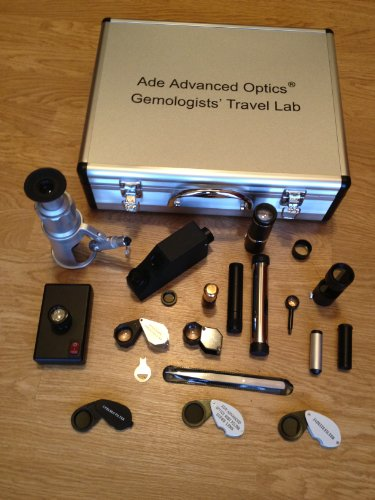 - Gemologists' Travel/portable Lab Suitcase. Including Microscope, Dichroscope, Spectroscope, Chelsea Filter, Ruby Filter, Jadeite Filter, Polariscope, Darkfield Loupe, Uv Magnifier, Gem Refractometer, Polariscope, Conoscope, Refractive Index Liquid Oil, Gem Tweizer and Etc.