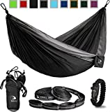 Black and Grey Flagship-X Double Hammock fits 2 adults. Comes with everything including hammock, tree straps, carabiners, and a fire-starting survival paracord bracelet.