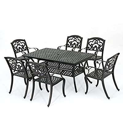 "GDF Studio 300679 Ariel Outdoor 7 Pc Cast Aluminum Dining Set with Extension Leaf, Copper - This dining set is a wonderful addition for any patio. Comes complete with matching table And chairs made from lightweight, rust resistant cast aluminum for a durable, outdoor Dining set. With seating for six, and a removable leaf, this set was designed for any and all hosting types. Have everyone over this summer to show off your new, stylish, cast aluminum dining set Includes: one (1) Table and six (6) chairs Dimensions with leaf: 37. 40""D x 81. 10""W x 29. 30""H 