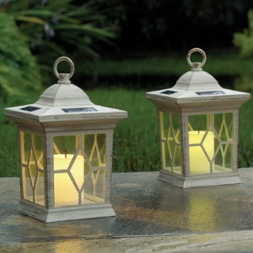 Set de 2 faroles solares para jardín, con velas parpadeantes: Amazon.es: Jardín